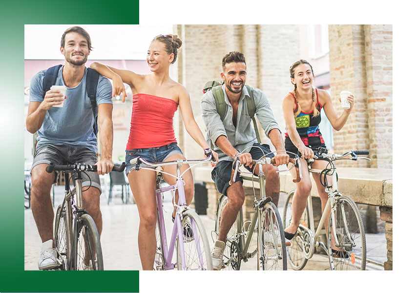 Group of four friends riding bikes